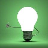 Light bulb character giving thumb up on green Stock Photo