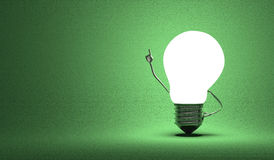Light bulb character in moment of insight on green Stock Image