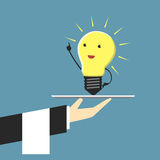 Light bulb character on plate Stock Photo