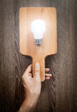 Light bulb on chopping board, serve idea concept Royalty Free Stock Photography