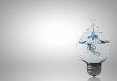 Light bulb with clear water Stock Photo