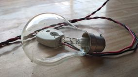 Light bulb. Clear light bulb on wire and switch Stock Images