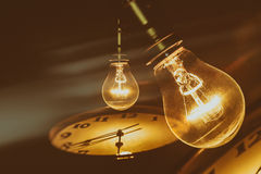 Light bulb and clock Stock Image