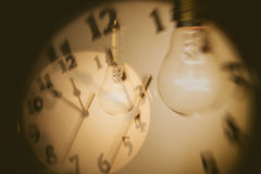 Light bulb and clock Royalty Free Stock Photo