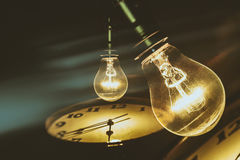 Light bulb and clock Stock Photography