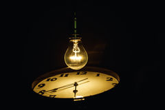 Light bulb and clock Stock Images