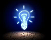Light bulb. Close up of glowing light bulb in desert Royalty Free Stock Images