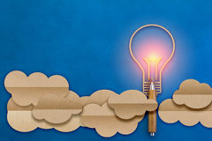 Light bulb in a cloud shape paper flat style with wooden pencil Stock Photo