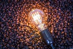 Light bulb on  coffee beans Royalty Free Stock Photos