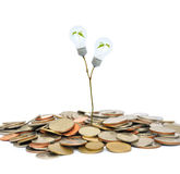 Light bulb and coin Stock Image