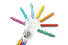 Light bulb and color pencils Stock Image