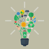 Light bulb with colorful eco icons Royalty Free Stock Images