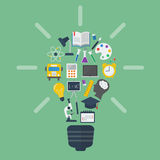 Light bulb with colorful education icons Royalty Free Stock Image