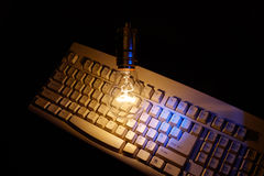 Light bulb and computer keyboard Royalty Free Stock Photos