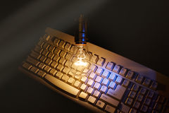 Light bulb and computer keyboard Royalty Free Stock Photography