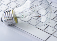 Light bulb and computer keyboard Royalty Free Stock Photo