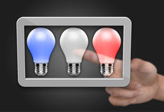 Light bulb in computer tablet Royalty Free Stock Image