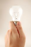Light bulb concept. Hand holding a light bulb Royalty Free Stock Photography