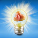 Light bulb concept with a red shape of a heart inside Royalty Free Stock Images