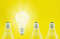 Light Bulb concept. Light bulb on yellow background Stock Photos