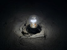 Light bulb on the concrete wall Royalty Free Stock Photography