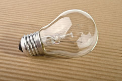 Light bulb on corrugated board Stock Photography