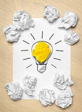 Light bulb crumpled paper Stock Photos