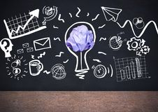 Light bulb with crumpled paper ball in front of blackboard Royalty Free Stock Photo