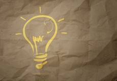 Light bulb crumpled recycle paper background Royalty Free Stock Image