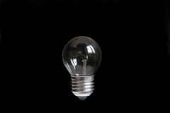 Light bulb on a dark background. Royalty Free Stock Image