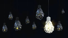 Light bulb on dark background. debris Stock Photos
