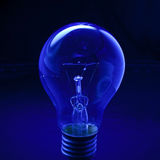 Light bulb with dark blue low key background conception for idea creative Stock Photos