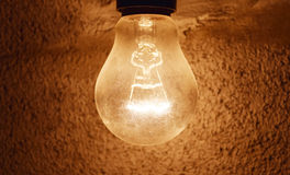 Light bulb. Light in the dark wall night light electricity Royalty Free Stock Images