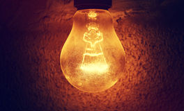 Light bulb. Light in the dark wall night light electricity Royalty Free Stock Image
