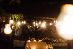 Light bulb decor in outdoor party. Wedding
