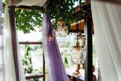 Light bulb decor in outdoor wedding ceremony