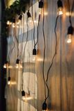 Light bulb decor at wall in outdoor party