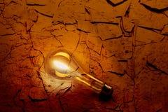 Light bulb on desert floor Royalty Free Stock Photography