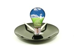 Light bulb on dish isolated. Royalty Free Stock Image