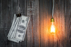 Light bulb and dollar hang Stock Photo