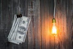 Light bulb and dollar hang Stock Photo