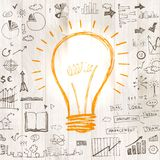 Light bulb with drawing business success strategy Royalty Free Stock Images