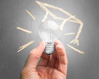 Light bulb with drawing educational hat Royalty Free Stock Images