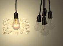 Light bulb with drawing graph Stock Image