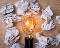 Light bulb  and  drawing graph inside with Crumpled paper on woo Stock Photo