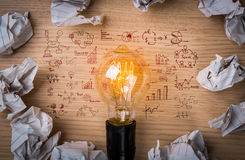 Light bulb with drawing graph shines Royalty Free Stock Photo