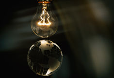 Light bulb and earth Royalty Free Stock Photos