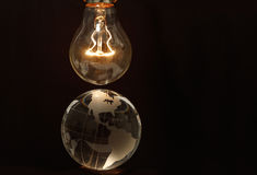 Light bulb and earth Royalty Free Stock Photography