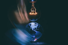 Light bulb and earth Royalty Free Stock Image