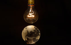 Light bulb and earth Royalty Free Stock Images